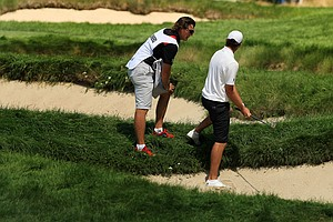 Corey Conners and his caddie Garrett Rank look over his shot at No. 6 during the quarterfinals at the 2013 U. S. Amateur at The Country Club.