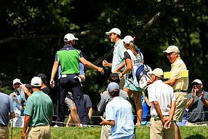 Brady Watt congratulates Scottie Scheffler after Scheffler made a hole-in-one at No. 7 during the quarterfinals at the 2013 U. S. Amateur at The Country Club.