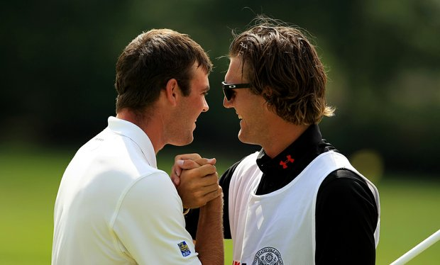 Corey Conners celebrates with his caddie Garrett Rank after they defeated Neil Raymond during the quarterfinals at the 2013 U. S. Amateur at The Country Club.