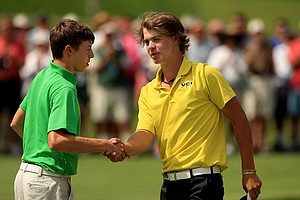 Adam Ball shakes hands with Matt Fitzpatrick after he lost 4 and 3 during the quarterfinals at the 2013 U. S. Amateur at The Country Club.