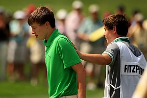 Alex Fitzpatrick patts his brother, Matthew, on the back after they defeated Adam Ball during the quarterfinals at the 2013 U. S. Amateur at The Country Club.