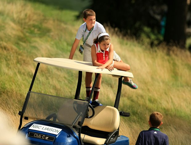 A couple of young spectators find a higher vantage point during the quarterfinals at the 2013 U. S. Amateur at The Country Club.