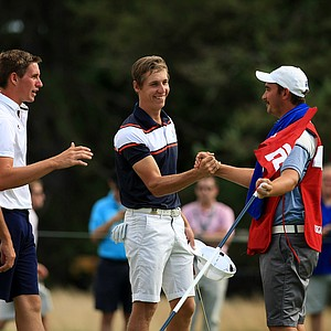 Oliver Goss, center, defeated Brandon Matthews 5 and 3 during the quarterfinals at the 2013 U. S. Amateur at The Country Club.
