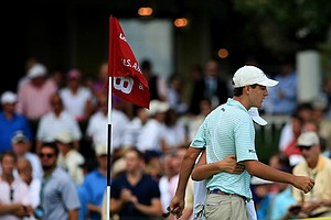 Scottie Scheffler and his sister/caddie Callie Scheffler leave No. 18 after being defeated 1 up by Brady Watt during the quarterfinals at the 2013 U. S. Amateur at The Country Club.