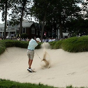 Scottie Scheffler hits his bunker shot at No. 18 during the quarterfinals at the 2013 U. S. Amateur at The Country Club.