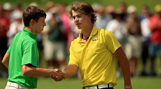 Adam Ball shakes hands with Matthew Fitzpatrick after Ball lost 4 and 3 during the quarterfinals at the 2013 U. S. Amateur at The Country Club.