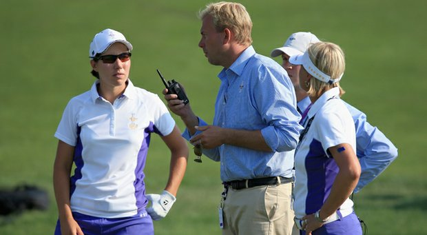 LPGA rules official Brad Alexander (center) talks with Carlota Ciganda (left) and the European captain Liselotte Neumann (right) as they attempt to figure out where to drop Ciganda's ball on the 15th hole.