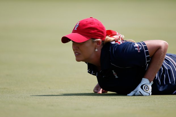 Cristie Kerr of the U.S. lines up a putt on the 17th green during the Friday morning foursomes matches at the 2013 Solheim Cup.