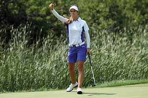 Europe's Azahara Munoz celebrates as she sinks a putt on the 17th hole to clinch victory with her teammate Karine Icher over Cristie Kerr and Paula Creamer during the Friday morning foursomes matches at the 2013 Solheim Cup.