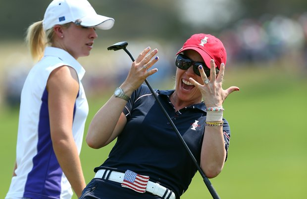 Morgan Pressel of the U.S. Solhiem Cup team celebrates after winning her match 3 and 2 during the Friday foursomes matches at 2013 Solheim Cup.