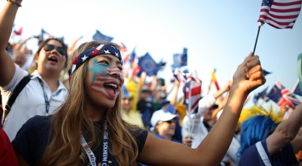 Fans support the U.S. team on the first tee during the morning foursomes matches at the 2013 Solheim Cup.