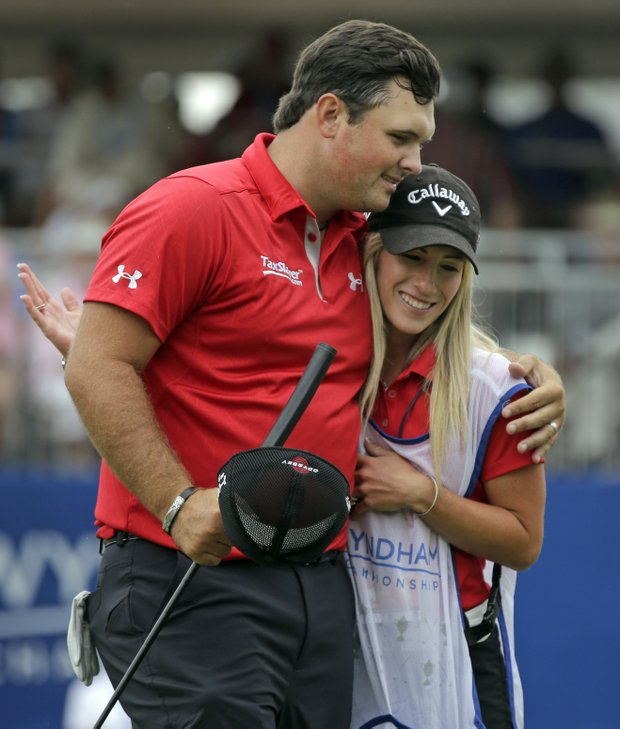 Patrick Reed and his caddie, wife Justine, during the second round of the 2013 Wyndham Championship in Greensboro, N.C.