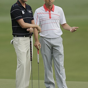 Webb Simpson (left) and Sergio Garcia during the second round of the 2013 Wyndham Championship in Greensboro, N.C.
