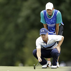 Jordan Spieth and his caddie during the second round of the 2013 Wyndham Championship in Greensboro, N.C.