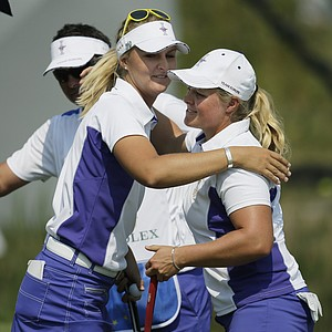Suzann Pettersen and Caroline Hedwall celebrate after a morning foursomes victory during the first day of 2013 Solheim Cup play at Colorado Golf Club.