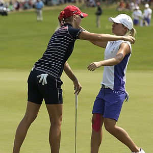 Jessica Korda (left) and Jodi Ewart Shadoff hug after their morning match during the first day of 2013 Solheim Cup play at Colorado Golf Club.