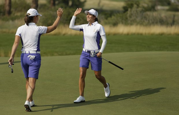 European teammates Azahara Munoz and Karine Icher during the first day of 2013 Solheim Cup play at Colorado Golf Club.