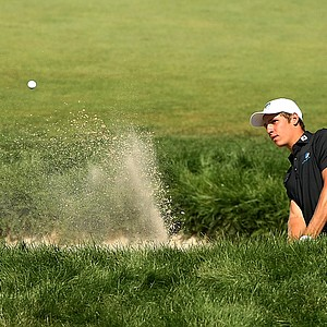 Oliver Goss hits out of the bunker at No. 9 during the semifinals at the 2013 U. S. Amateur at The Country Club.