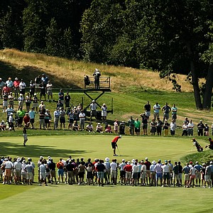 A crowd watches as Corey Conners putts at No. 13 during the semifinals at the 2013 U. S. Amateur at The Country Club.