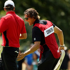 Garrett Rank, caddie for Corey Conners, gives him a friendly pat for making birdie at No. 16 during the semifinals at the 2013 U. S. Amateur at The Country Club.