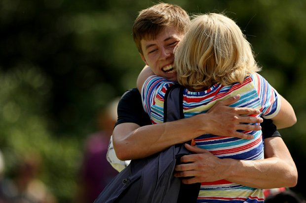 Matt Fitzpatrick gets a big hug from his mom, Sue, after winning his match 2 and 1 during the semifinals at the 2013 U. S. Amateur at The Country Club.
