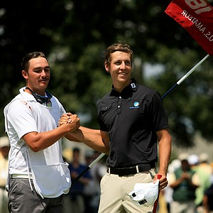 Oliver Goss celebrates with his caddie Taylor Macdonald during the semifinals at the 2013 U. S. Amateur at The Country Club.