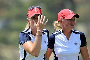 Paula Creamer (left) and Stacy Lewis of the U.S. celebrate winning their match on the 18th green during the morning foursomes matches for the 2013 Solheim Cup.
