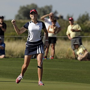 United States' Paula Creamer celebrates a birdie on the fourth hole during a foursome match in the Solheim Cup.