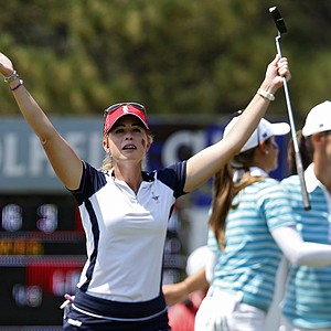 United States' Paula Creamer celebrates on the 18th hole after she and Stacy Lewis won their foursomes match against Europe's Azahara Munoz, of Spain, and Karine Icher, from France, at the Solheim Cup.