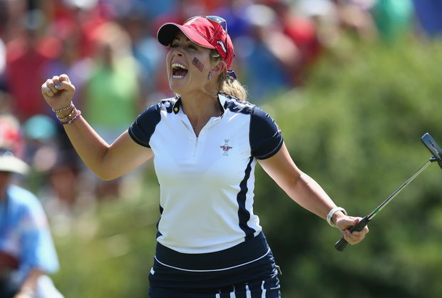 Paula Creamer of the U.S. reacts after making a putt to win the 15th hole during the Saturday foursomes matches at the 2013 Solhiem Cup.