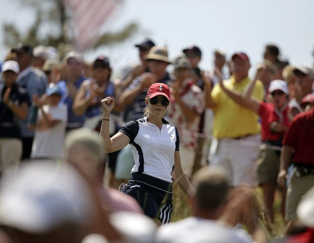 United States' Paula Creamer walks through the gallery at the 17th tee during a foursome match in the Solheim Cup.