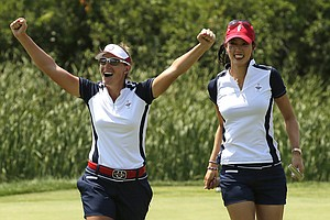 United States' Michelle Wie, right, and teammate Brittany Lang celebrate after the pair won their foursome match in the Solheim Cup.