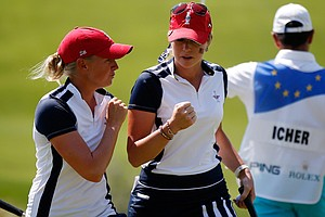 Stacy Lewis (left) and Paula Creamer of the United States react after winning the 15th hole during the morning foursomes matches for the 2013 Solheim Cup.