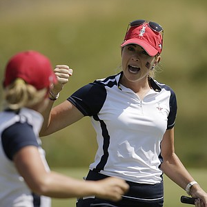 United States' Paula Creamer (right) and teammate Stacy Lewis celebrate their birdie on the 16th hole during a foursome match in the Solheim Cup.