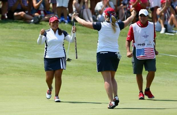 Lizette Salas and Brittany Lincicome celebrate on the 16th green during the Saturday Foursomes matches at the 2013 Solhiem Cup.