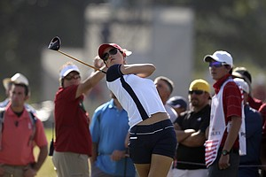 United States' Michelle Wie hits her tee shot on the seventh hole during a foursome match in the Solheim Cup.