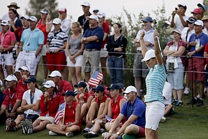 Europe's Karine Icher celebrates after chipping in for birdie on the 18th hole to win a four-ball match Saturday at the Solheim Cup.
