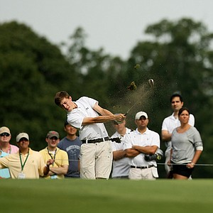 Matt Fitzpatrick hits a shot at No. 4 during the first 18 holes of the finals at the 2013 U. S. Amateur at The Country Club.
