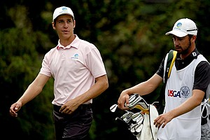 Oliver Goss with his fellow Australian teammate, Brady Watt, during the first 18 holes of the finals at the 2013 U. S. Amateur at The Country Club. Watt lost to Goss in the semifinals.