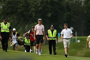 Oliver Goss and Matt Fitzpatrick walk up No. 14 during the first 18 holes of the finals at the 2013 U. S. Amateur at The Country Club.