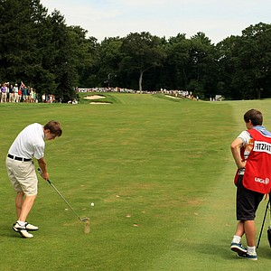 Matt Fitzpatrick hits a shot at No. 14 during the first 18 holes of the finals at the 2013 U. S. Amateur at The Country Club.