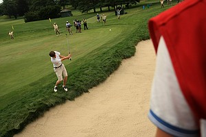 Just over the shoulder of Alex Fitzpatrick, caddie for Matt Fitzpatrick, Matt hits a shoulder at No. 18 during the first 18 holes of the finals at the 2013 U. S. Amateur at The Country Club.