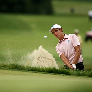 Oliver Goss hits a bunker shot at No. 11, the 29th hole during the finals at the 2013 U. S. Amateur at The Country Club.