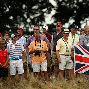 Fans hold up the British flag at No. 12, the 30th hold during the finals at the 2013 U. S. Amateur at The Country Club.