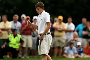 Matt Fitzpatrick pumps his fist after sinking his final putt at No. 15, the 33rd hole, during the finals at the 2013 U. S. Amateur at The Country Club.