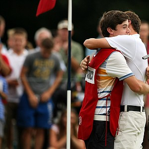 Matt Fitzpatrick tightly hugs his brother, Alex, after winning 4 and 3 over Oliver Goss at the 2013 U. S. Amateur at The Country Club.