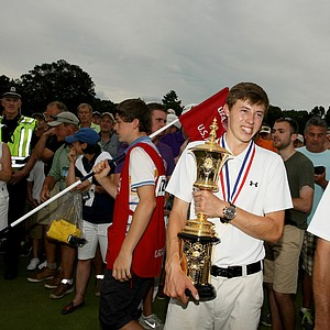 Matt Fitzpatrick proudly holds the Havemeyer trophy after defeating Oliver Goss 4 and 3 at the 2013 U. S. Amateur at The Country Club.
