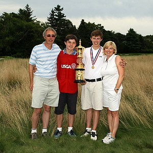 Matt Fitzpatrick poses with his family, dad, Russell, brother Alex and mom Sue after winning the 2013 U. S. Amateur at The Country Club.