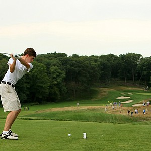 Matt Fitzpatrick hits his tee shot at No. 9, the 27th hole, during the finals at the 2013 U. S. Amateur at The Country Club.