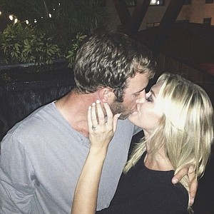 Dustin Johnson and Paulina Gretzky enjoy a kiss after their engagement, which she showed off on her Instagram feed.